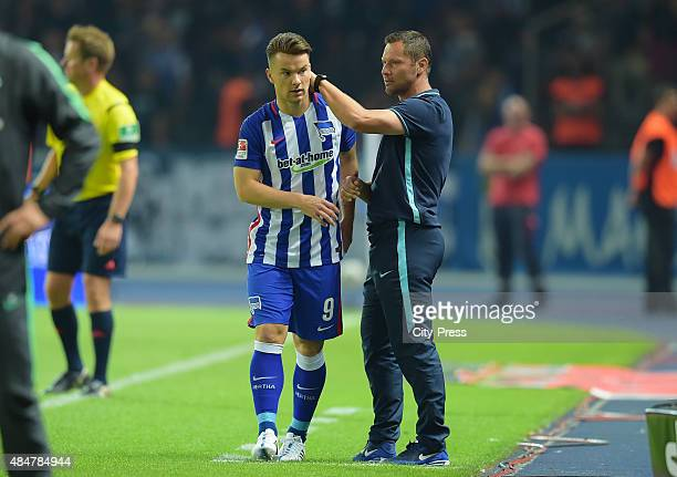 Alexander Baumjohann and coach Pal Dardai of Hertha BSC during the game between Hertha BSC and Werder Bremen on August 21 2015 in Berlin Germany
