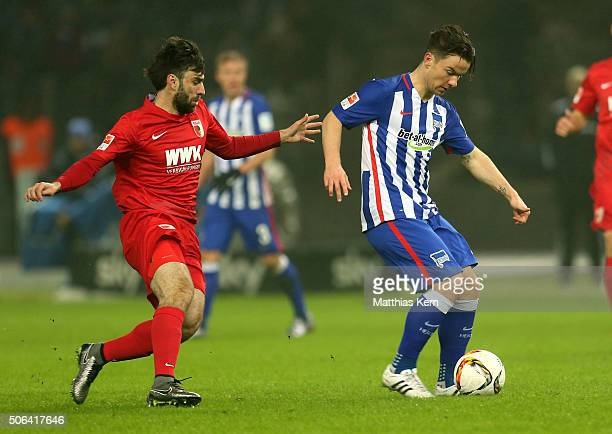 Alexander Baumjohann of Berlin battles for the ball with Jan Moravek of Augsburg during the Bundesliga match between Hertha BSC and FC Augsburg at...