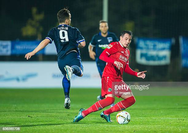 Alexander Baumjohann of Hertha BSC and Edgar Prib of Hannover 96 battle for the ball during the Friendly Match between Hannover 96 and Hertha BSC at...