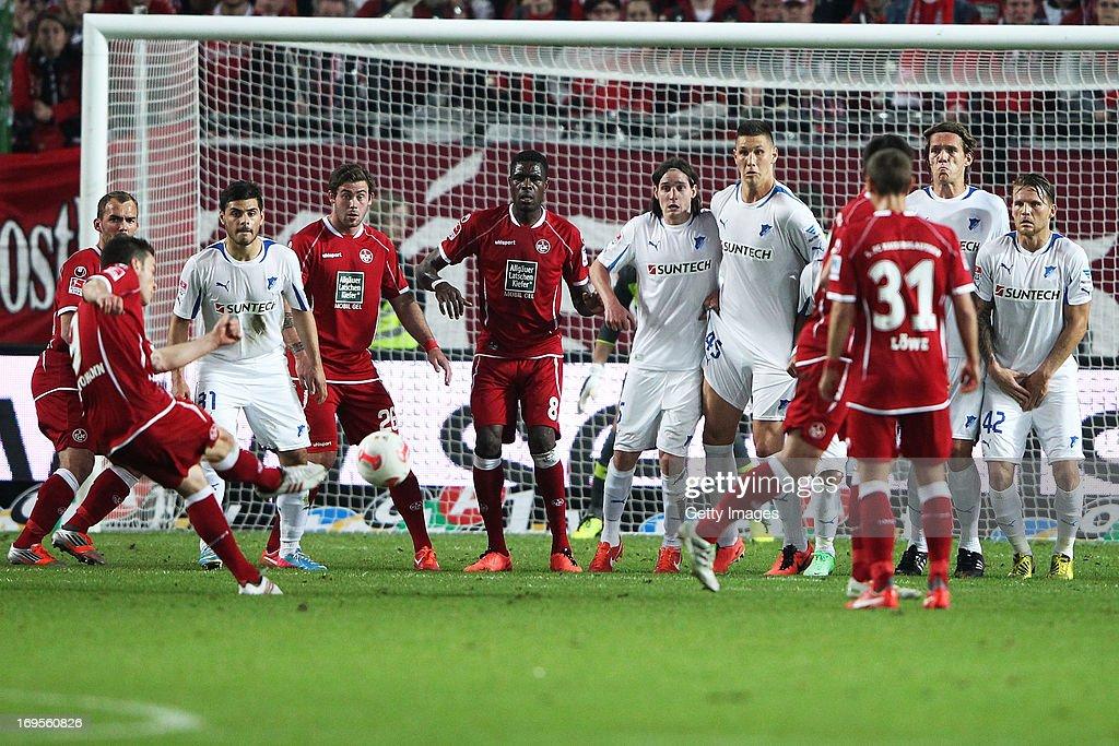 Alexander Baumjohann of Kaiserslautern scores his team's first goal against during the Bundesliga Playoff Second Leg match between 1 FC...