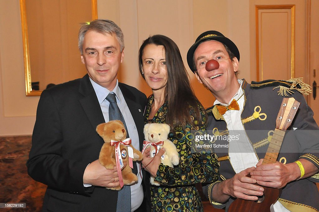 Alexander Betanishvili, Brigitte Just and a clown attend the Christmas ball for children Energy For Life - Heat For Children's Hearts at Hofburg Vienna on December 11, 2012 in Vienna, Austria.