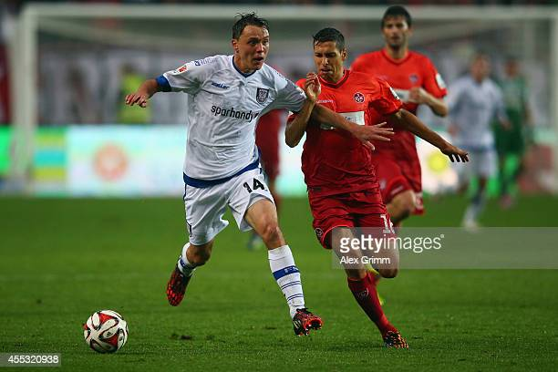 Alexander Bittroff of Frankfurt is challenged by Karim Matmour of Kaiserslautern during the Second Bundesliga match between 1 FC Kaiserslautern and...