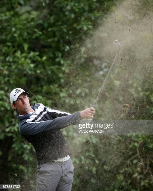 Alexander Bjork of Sweden hits a shot on the 12th hole during round three of the Hong Kong Open tournament at the Hong Kong Golf Club on November 25...