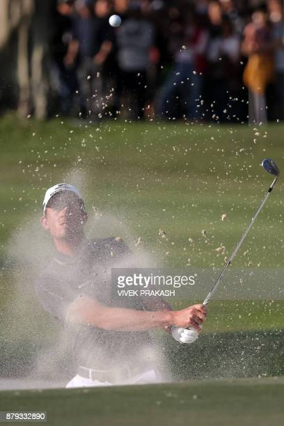 Alexander Bjork of Sweden hits a shot out of the bunker onto the 18th green during the final round of the Hong Kong Open golf tournament at the Hong...