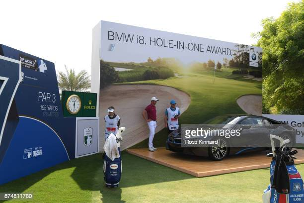Alexander Bjork of Sweden looks at the BMW car on the 17th hole during the first round of the DP World Tour Championship at Jumeirah Golf Estates on...