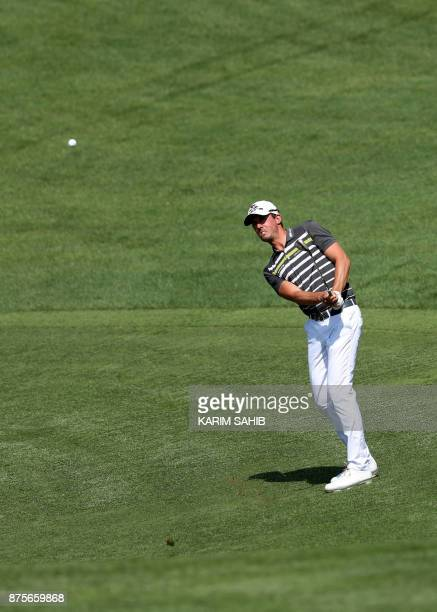 Alexander Bjork of Sweden plays a shot during the third round of the DP World Tour Championship at Jumeirah Golf Estates in Dubai on November 18 2017...