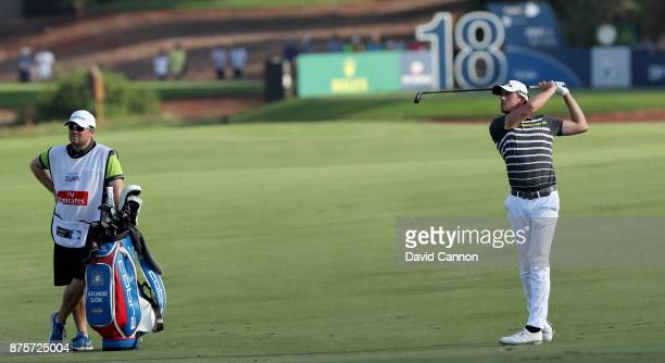 Alexander Bjork of Sweden plays his second shot on the 18th hole during the third round of the 2017 DP World Tour Championship on the Earth Course at...