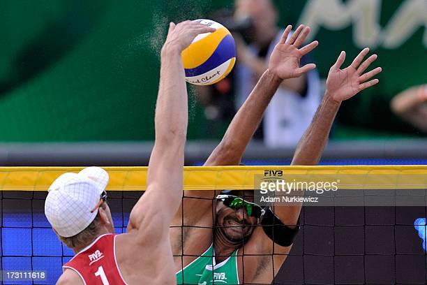 Alexander Brouwer of the Netherlands attacks against Ricardo Alex Costa Santos of Brazil during the men's final match between the Netherlands and...
