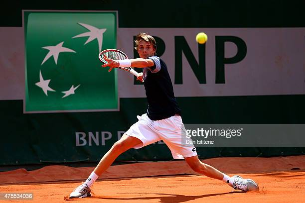 Alexander Bublik of Russia in action during his boys singles match against William Blumberg of the United States on day nine of the 2015 French Open...