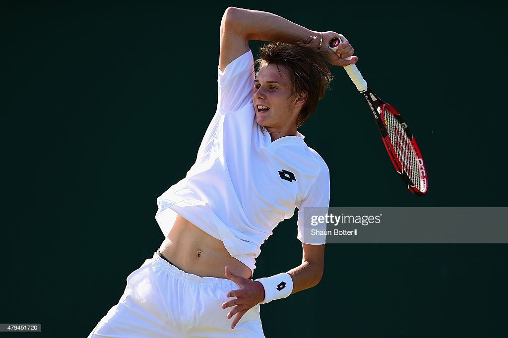 Alexander Bublik of Russia in action during the Boys Singles First Round match against Stefanos Tsitsipas of Greece during day six of the Wimbledon Lawn Tennis Championships at the All England Lawn Tennis and Croquet Club on July 4, 2015 in London, England.
