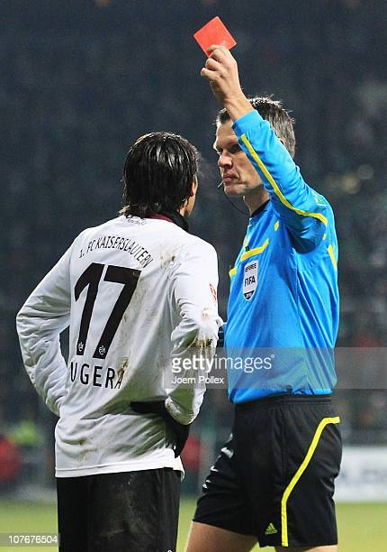 Alexander Bugera of Kaiserslautern gets the red card from referee Michael Weiner during the Bundesliga match between SV Werder Bremen and 1 FC...