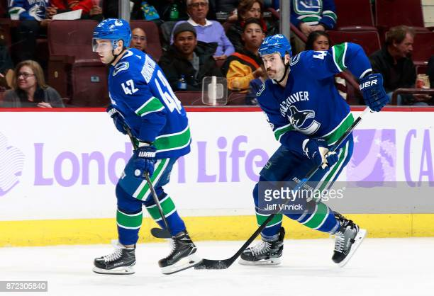 Alexander Burmistrov and Erik Gudbranson of the Vancouver Canucks skate up ice during their NHL game against the Detroit Red Wings at Rogers Arena...