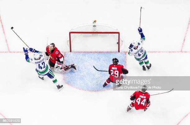 Alexander Burmistrov of the Vancouver Canucks celebrates his second period goal with team mate Sven Baertschi as Craig Anderson Johnny Oduya and...