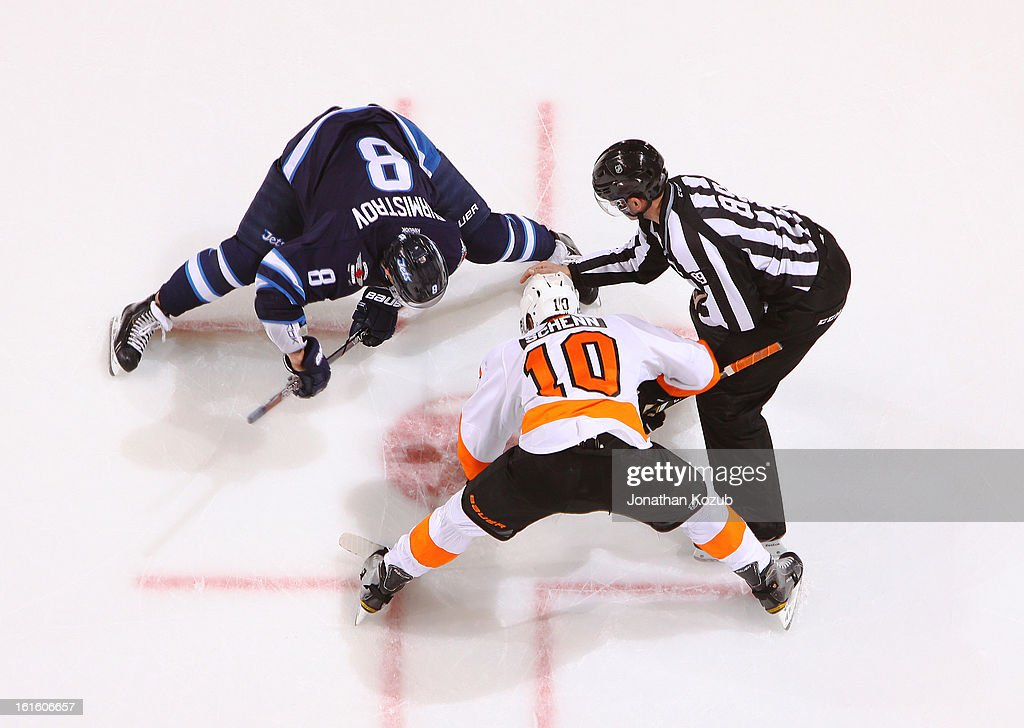 <a gi-track='captionPersonalityLinkClicked' href=/galleries/search?phrase=Alexander+Burmistrov&family=editorial&specificpeople=4782297 ng-click='$event.stopPropagation()'>Alexander Burmistrov</a> #8 of the Winnipeg Jets takes a second period faceoff against <a gi-track='captionPersonalityLinkClicked' href=/galleries/search?phrase=Brayden+Schenn&family=editorial&specificpeople=4782304 ng-click='$event.stopPropagation()'>Brayden Schenn</a> #10 of the Philadelphia Flyers at the MTS Centre on February 12, 2013 in Winnipeg, Manitoba, Canada.