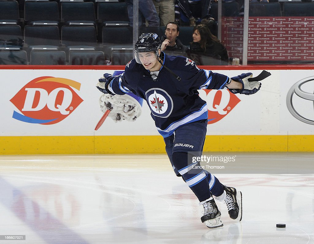 <a gi-track='captionPersonalityLinkClicked' href=/galleries/search?phrase=Alexander+Burmistrov&family=editorial&specificpeople=4782297 ng-click='$event.stopPropagation()'>Alexander Burmistrov</a> #8 of the Winnipeg Jets takes part in the pre-game warm up prior to NHL action against the Florida Panthers at the MTS Centre on April 11, 2013 in Winnipeg, Manitoba, Canada.