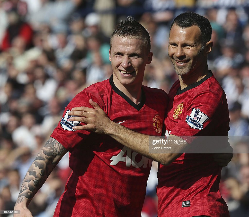 Alexander Buttner (L) and Ryan Giggs of Manchester United celebrate their part i Javier 'Chicharito' Hernandez scoring their fifth goal during the Barclays Premier League match between West Bromwich Albion and Manchester United at The Hawthorns on May 19, 2013 in West Bromwich, England.