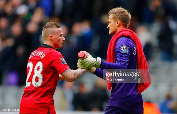Alexander Buttner of Manchester United and Anders Lindegaard of Manchester United during the Barclays Premier League match between Newcastle United...