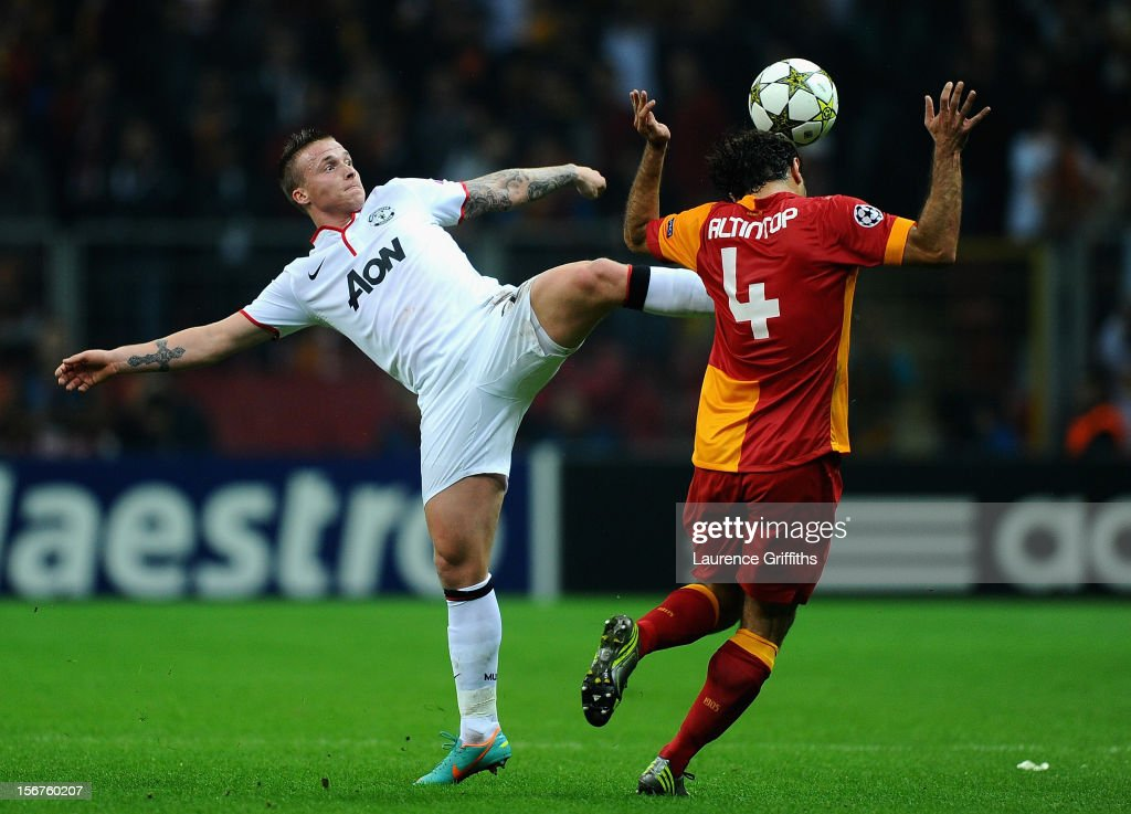 Alexander Buttner of Manchester United battles with <a gi-track='captionPersonalityLinkClicked' href=/galleries/search?phrase=Hamit+Altintop&family=editorial&specificpeople=597992 ng-click='$event.stopPropagation()'>Hamit Altintop</a> of Galatasary during the UEFA Champions League Group H match between Galatasaray and Manchester United at the Turk Telekom Arena on November 20, 2012 in Istanbul, Turkey.
