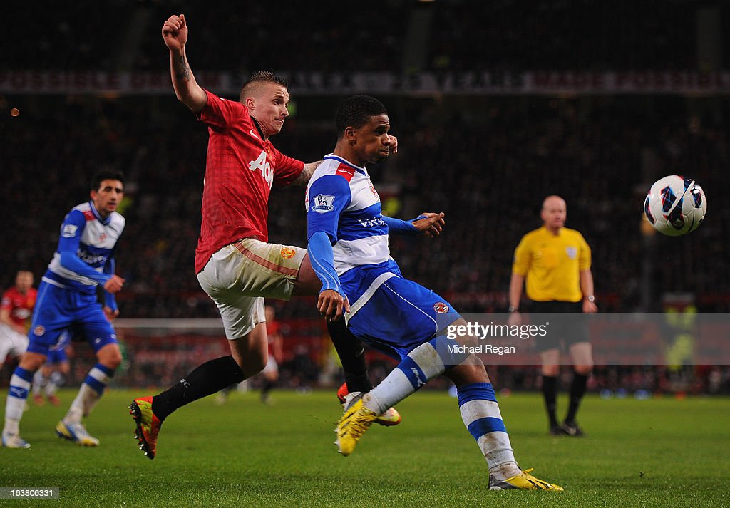 Alexander Buttner of Manchester United competes with Hal Robson-Kanu of Reading during the Barclays Premier League match between Manchester United and Reading at Old Trafford on March 16, 2013 in Manchester, England.