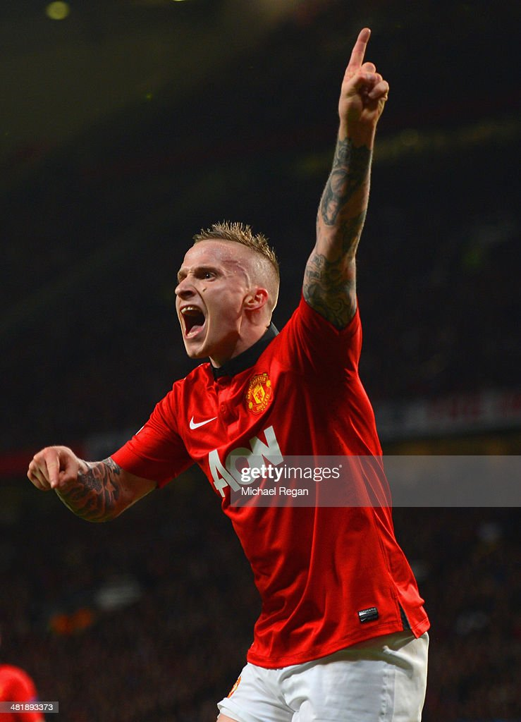 Alexander Buttner of Manchester United reacts during the UEFA Champions League Quarter Final first leg match between Manchester United and FC Bayern Muenchen at Old Trafford on April 1, 2014 in Manchester, England.