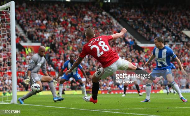 Alexander Buttner of Manchester United scores the third goal during the Barclays Premier League match between Manchester United and Wigan Athletic at...
