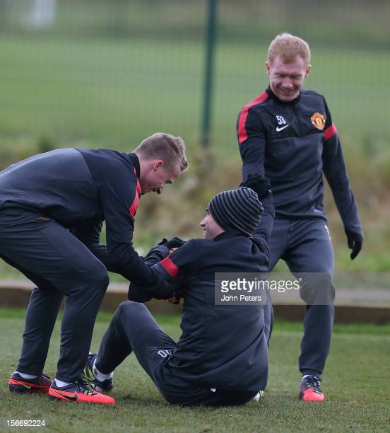 Alexander Buttner Robin van Persie and Paul Scholes of Manchester United in action during a first team training session ahead of their UEFA Champions...