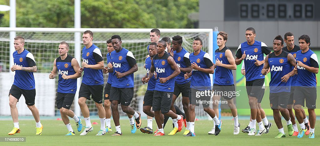 Alexander Buttner, Tom Cleverley, Phil Jones, Danny Welbeck, Rafael da Silva, Ashley Young, Michael Keane, Wilfried Zaha, Jesse Lingard, Adnan Januzaj, Anderson, Chris Smalling, Rio Ferdinand and Fabio da Silva of Manchester United in action during a first team training session as part of their pre-season tour of Bangkok, Australia, Japan and Hong Kong on July 28, 2013 in Hong Kong, Hong Kong.