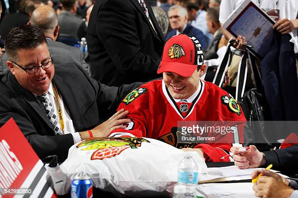 Alexander Debrincat reacts after being selected 39th by the Chicago Blackhawks during the 2016 NHL Draft on June 25 2016 in Buffalo New York