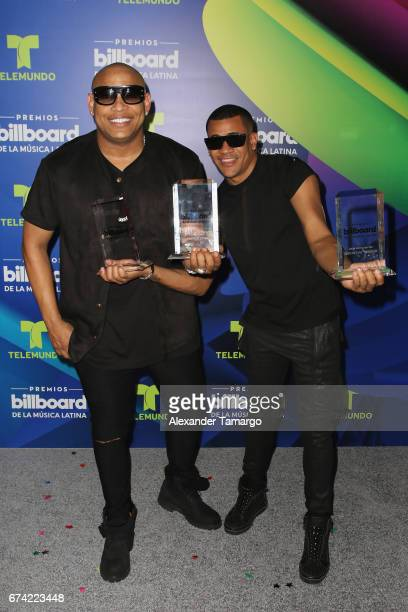 Alexander Delgado and Randy Malcolm of Gente De Zona pose with awards in the press room during the Billboard Latin Music Awards at Watsco Center on...
