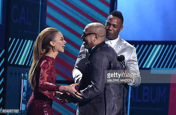 Alexander Delgado of Gente de Zona accepts the award for Best Tropical Fusion Album from Leslie Grace and Arnoldis Chapman during the show of the...