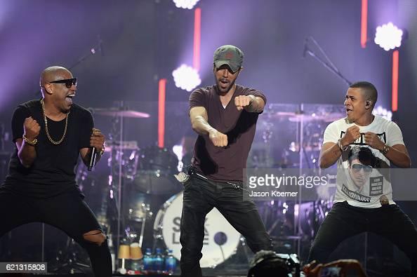 Alexander Delgado of the group Gente de Zona and Enrique Iglesias and Randy Malcom of Gende de Zona perform on stage at iHeartRadio Fiesta Latina at...