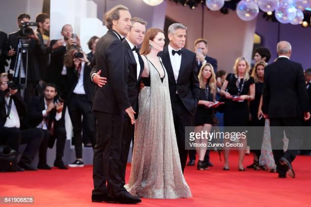 Alexander Desplat Matt Damon Julianne Moore and George Clooney walk the red carpet ahead of the 'Suburbicon' screening during the 74th Venice Film...