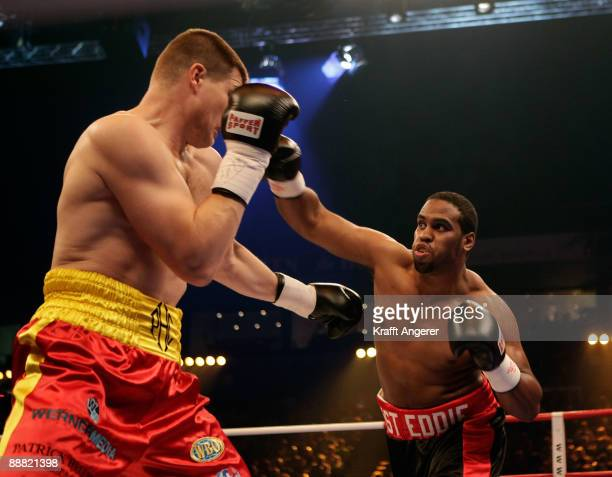 Alexander Dimitrenko of Ukraine takes a punch on Eddie Chambers of USA during the WBO Eliminator Heavyweight fight between Alexander Dimitrenko of...