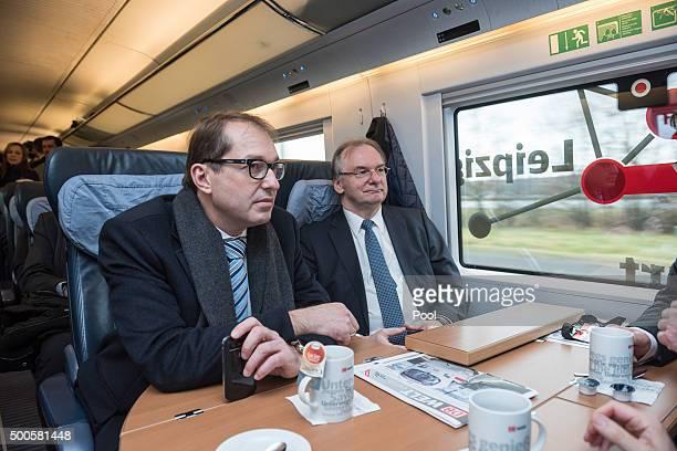 Alexander Dobrindt Federal Minister of Transport and digital infrastructure and Reiner Haseloff Prime Minister of SaxonyAnhalt ride on a highspeed...