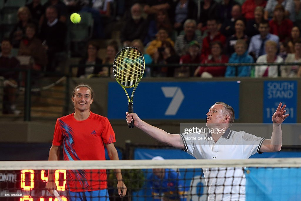 Alexander Dolgopolov (L) of the Ukraine and Premier of South Australia Jay Weatherill (R) plays together in a doubles match during the World Tennis Challenge at Memorial Drive on January 9, 2013 in Adelaide, Australia.