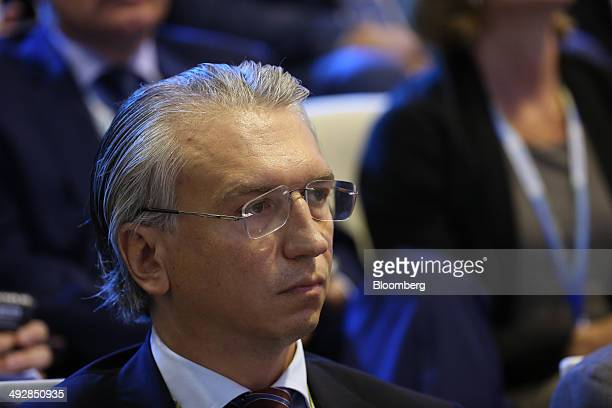 Alexander Dyukov chief executive officer of OAO Gazprom Neft listens during the Global CEO Summit on the opening day of the St Petersburg...