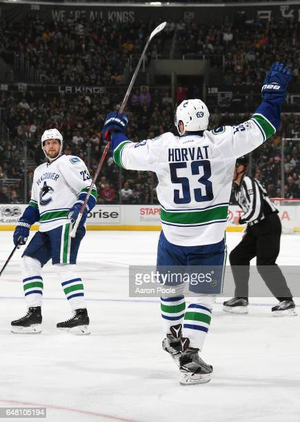 Alexander Edler and Bo Horvat of the Vancouver Canucks celebrate a second period goal during the game against the Los Angeles Kings on March 4 2017...
