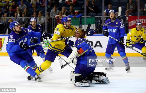Alexander Edler of Sweden fails to score over Frederic Cloutier goaltender of Italy for the puck during the 2017 IIHF Ice Hockey World Championship...