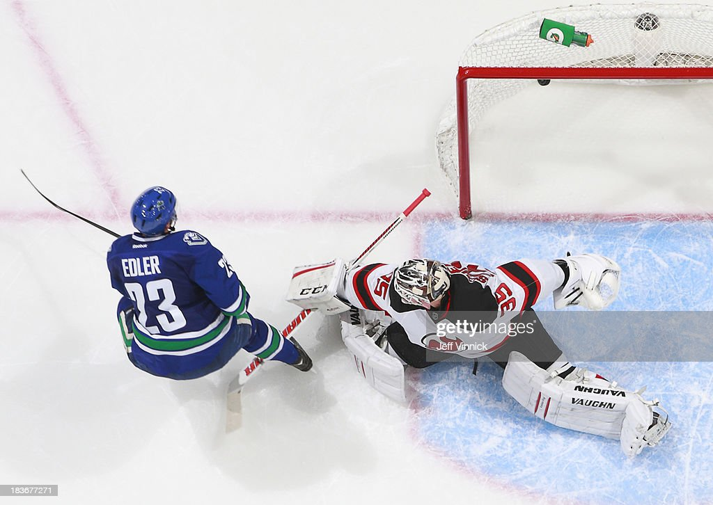 <a gi-track='captionPersonalityLinkClicked' href=/galleries/search?phrase=Alexander+Edler&family=editorial&specificpeople=882987 ng-click='$event.stopPropagation()'>Alexander Edler</a> #23 of the Vancouver Canucks beats <a gi-track='captionPersonalityLinkClicked' href=/galleries/search?phrase=Cory+Schneider&family=editorial&specificpeople=696908 ng-click='$event.stopPropagation()'>Cory Schneider</a> #35 of the New Jersey Devils for a goal during their NHL game at Rogers Arena on October 8, 2013 in Vancouver, British Columbia, Canada. Vancouver won 3-2.