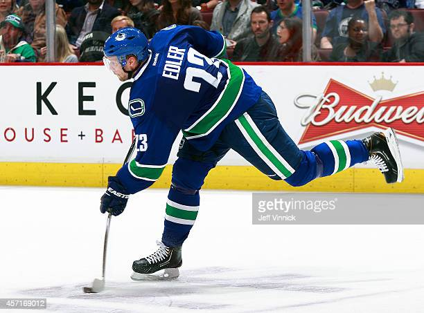 Alexander Edler of the Vancouver Canucks takes a shot during their NHL game against the Edmonton Oilers at Rogers Arena October 11 2014 in Vancouver...