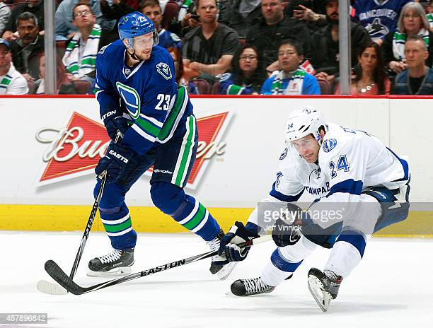 Alexander Edler of the Vancouver CanucksRyan Callahan of the Tampa Bay Lightning skate up ice during their NHL game at Rogers Arena October 18 2014...