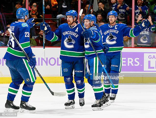 Alexander Edler Troy Stecher Henrik Sedin celebrate a goal by Daniel Sedin of the Vancouver Canucks against the Arizona Coyotes during their NHL game...
