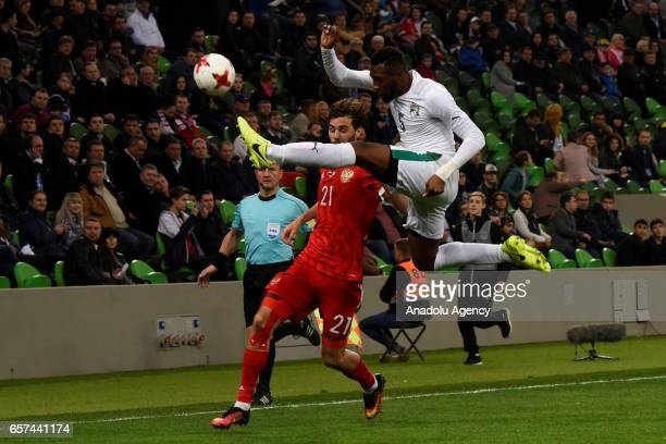 Alexander Erokhin of Russia in action against Wilfried Kanon of Cote d'Ivoire's during the friendly football match at Krasnodar Stadium in Krasnodar...