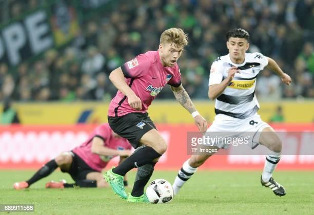 Alexander Esswein of Berlin and Mahmoud Dahoud of Moenchengladbach battle for the ball during the Bundesliga match between Borussia Moenchengladbach...
