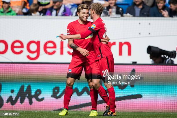 Alexander Esswein of Berlin celebrates his team's first goal with team mate Fabian Lustenberger during the Bundesliga match between TSG 1899...