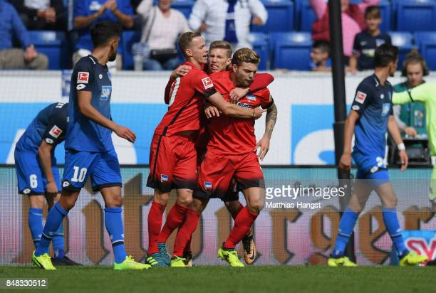 Alexander Esswein of Berlin celebrates with his teammates after scoring his team's first goal during the Bundesliga match between TSG 1899 Hoffenheim...