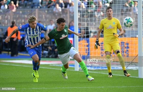 Alexander Esswein of Hertha BSC Milos Veljkovic and Jiri Pavlenka of Werder Bremen during the game between Hertha BSC and Werder Bremen on september...