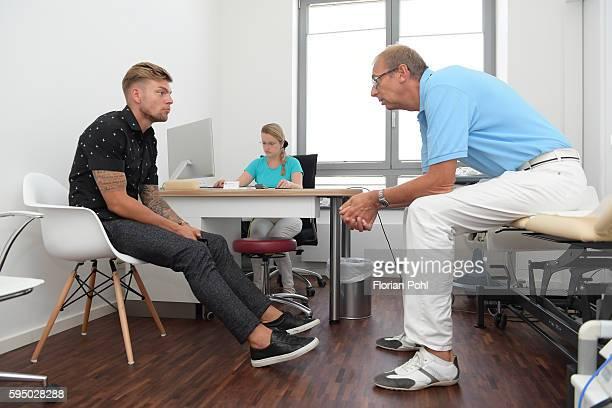 Alexander Esswein of Hertha BSC speaks with team doctor Dr med Ulrich Schleicher during the check up bei team doctor Dr med Ulrich Schleicher on...