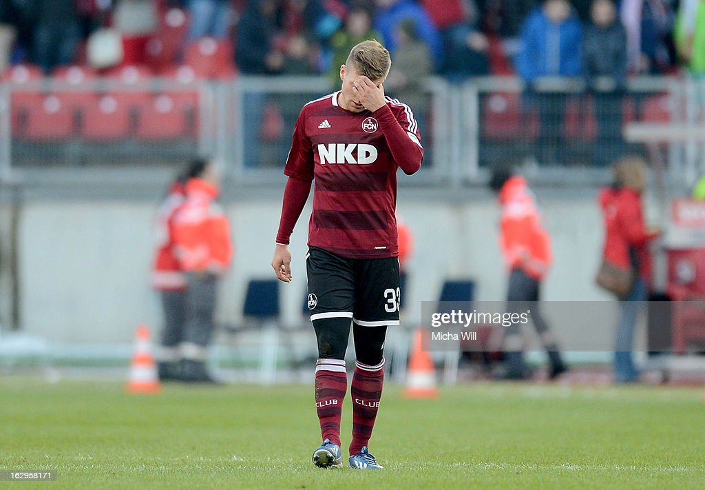 Alexander Esswein of Nuernberg appears dejected during the Bundesliga Match between 1. FC Nuernberg and SC Freibug at Grundig Stadion on March 2, 2013 in Nuremberg, Germany.