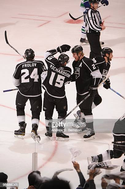 Alexander Frolov Brad Richardson and Matt Greene of the Los Angeles Kings celebrate after a goal against the Vancouver Canucks in Game Six of the...
